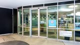 The glass sliding door entrance to Continuing Care Centre